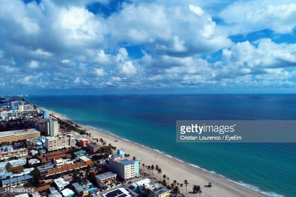 high angle view of sea and buildings against sky - hollywood florida stock pictures, royalty-free photos & images