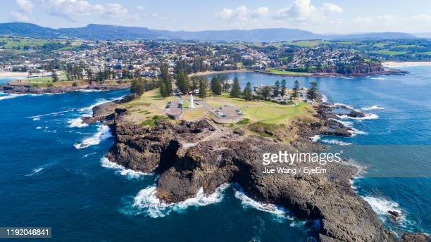 high angle view of sea and buildings against sky - wang he stock pictures, royalty-free photos & images