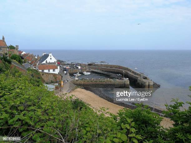 high angle view of sea and buildings against sky - lucinda lee stock photos and pictures