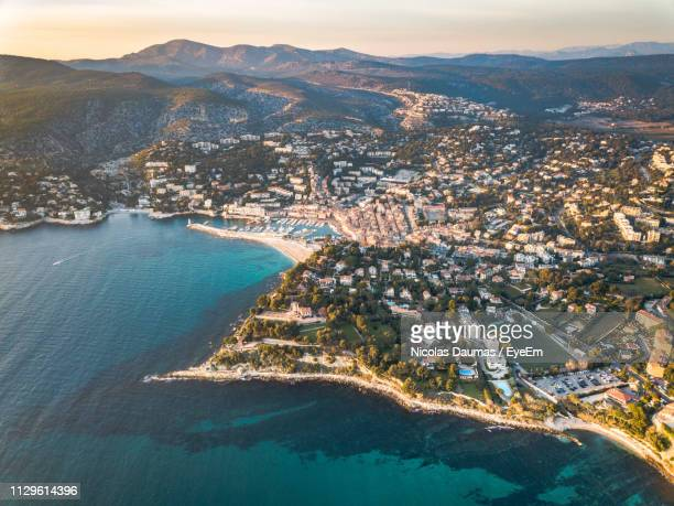 high angle view of sea and buildings in city - cassis stock pictures, royalty-free photos & images