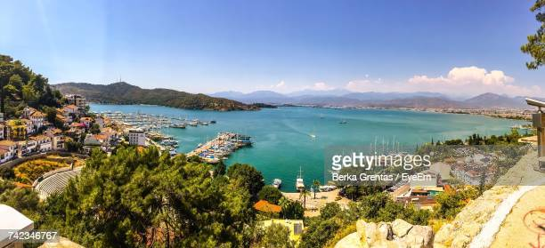 high angle view of sea and cityscape against blue sky - aegean turkey stock pictures, royalty-free photos & images
