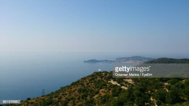 high angle view of sea and cityscape against clear sky - marica octavian stock photos and pictures