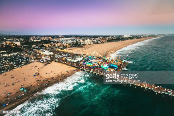 high angle view of sea and cityscape against sky - santa monica stock-fotos und bilder