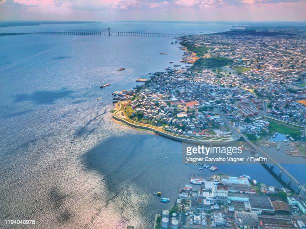 high angle view of sea and cityscape against sky - manaus stock pictures, royalty-free photos & images