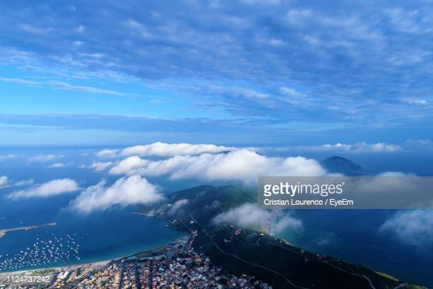 High Angle View Of Sea And Land Against Sky