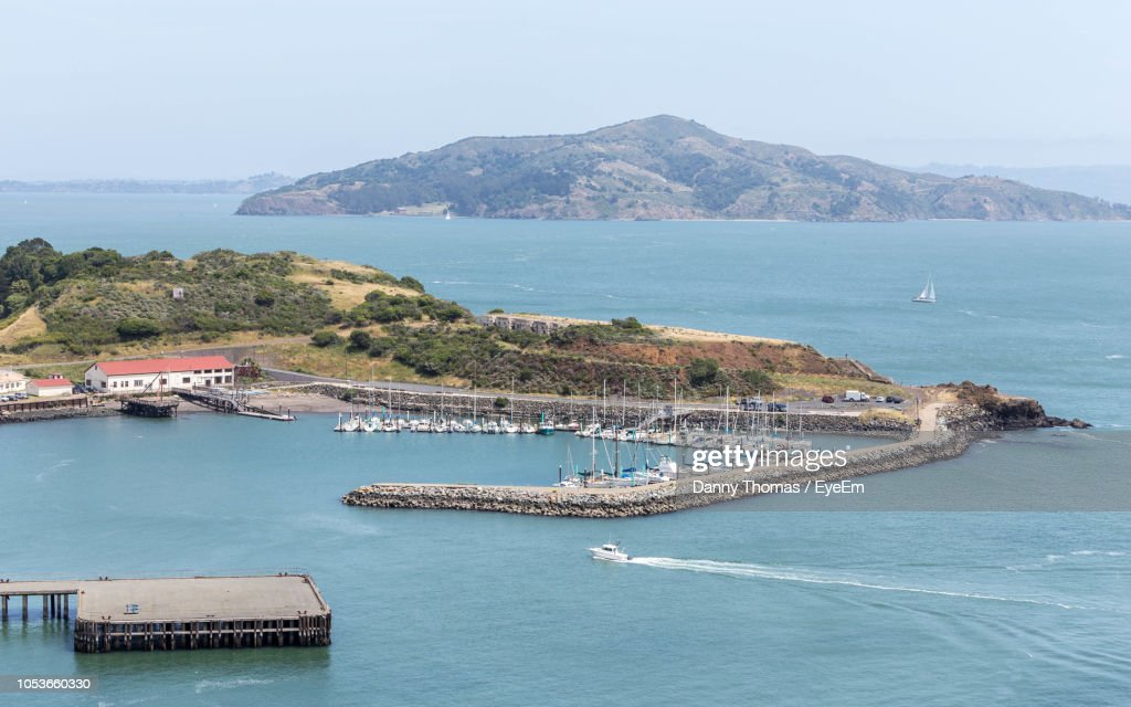 High Angle View Of Sea And Mountains Against Sky : Stock Photo