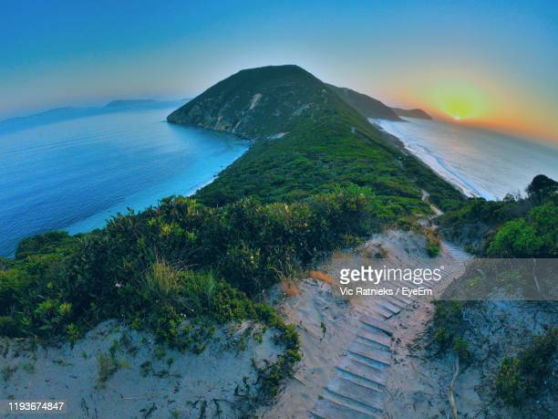 high angle view of sea and mountains against sky - ratnieks stock pictures, royalty-free photos & images