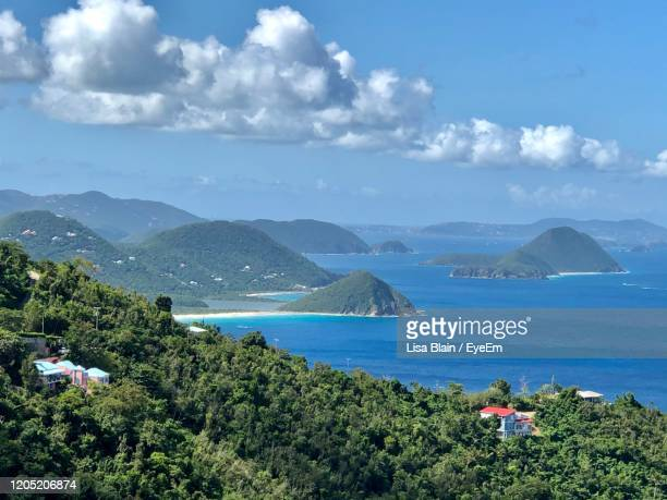 high angle view of sea and mountains against sky - cane garden bay stock pictures, royalty-free photos & images