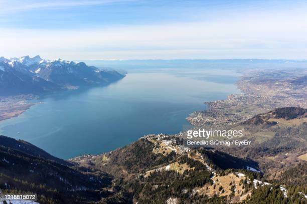high angle view of sea and mountains against sky - montreux stock pictures, royalty-free photos & images