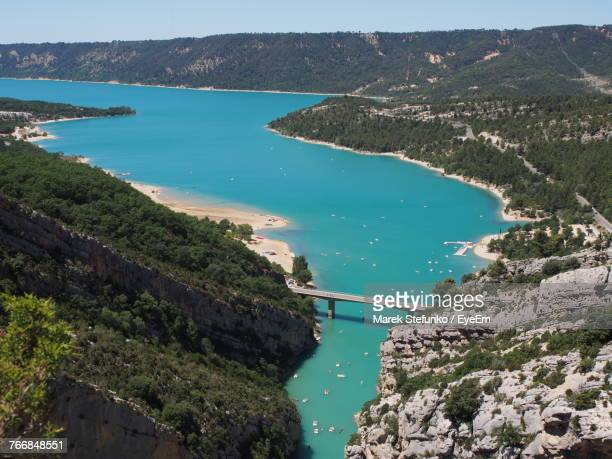 high angle view of sea and mountains against sky - marek stefunko stock photos and pictures