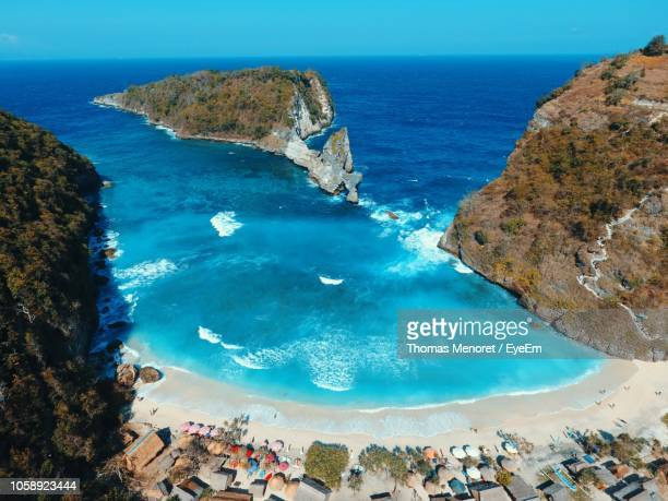high angle view of sea and rocks - denpasar stock pictures, royalty-free photos & images