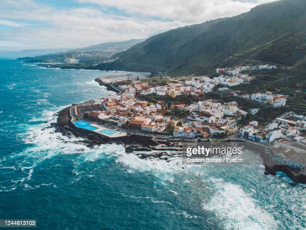 high angle view of sea by buildings against sky - bortes stock pictures, royalty-free photos & images