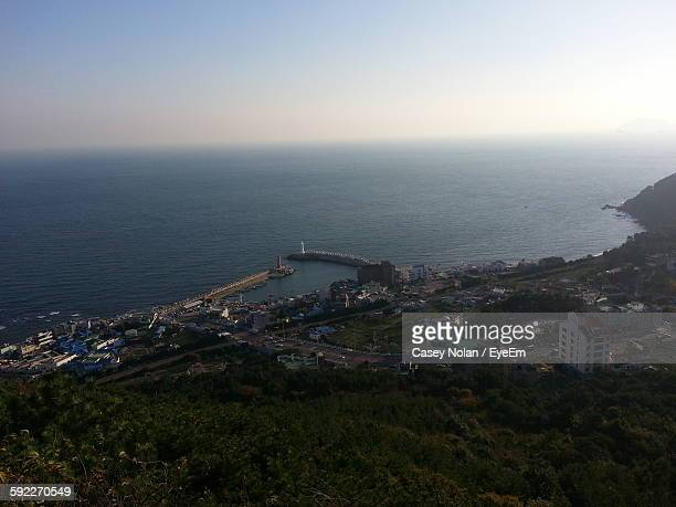 high angle view of sea by buildings against sky - casey nolan stock pictures, royalty-free photos & images