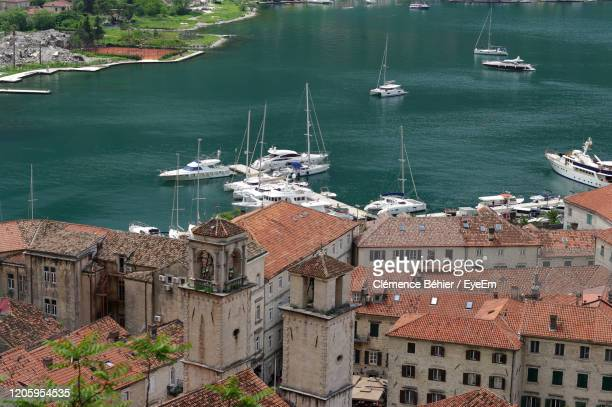 high angle view of sea by buildings in city - kotor bay stock pictures, royalty-free photos & images
