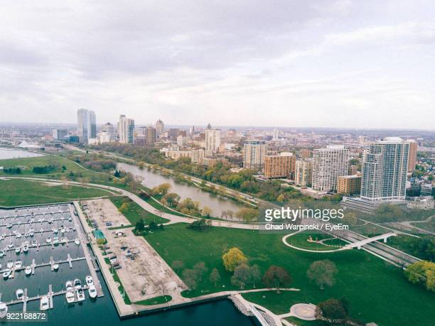 high angle view of sea by city against sky - milwaukee stock pictures, royalty-free photos & images