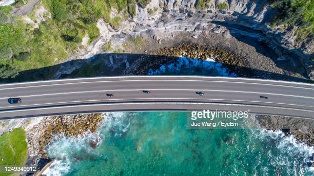 high angle view of sea cliff bridge in wollongong - wollongong stock pictures, royalty-free photos & images