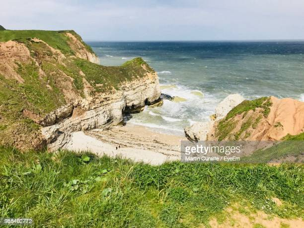 high angle view of sea shore against sky - bridlington stock pictures, royalty-free photos & images