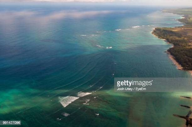high angle view of sea shore against sky - josh utley stock pictures, royalty-free photos & images