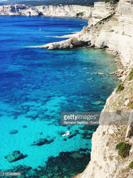 high angle view of sea shore - corsica photos et images de collection