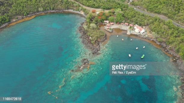 high angle view of sea shore - french overseas territory stock pictures, royalty-free photos & images
