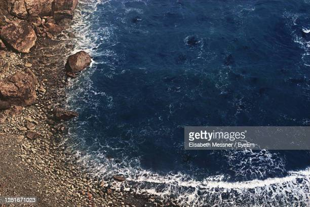 high angle view of sea waves - rocky coastline stock pictures, royalty-free photos & images