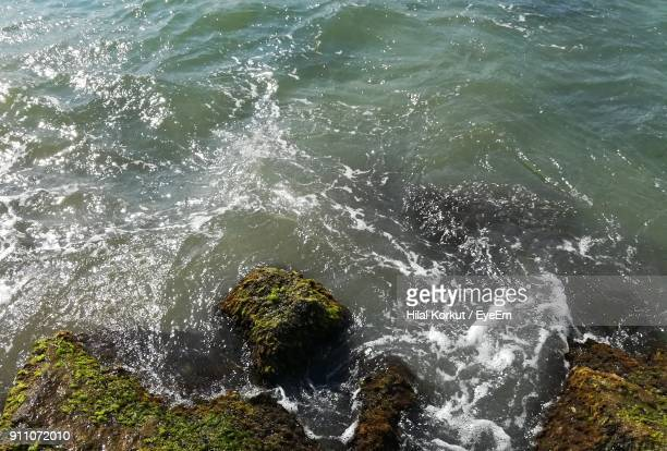 high angle view of sea waves - hilal stock photos and pictures