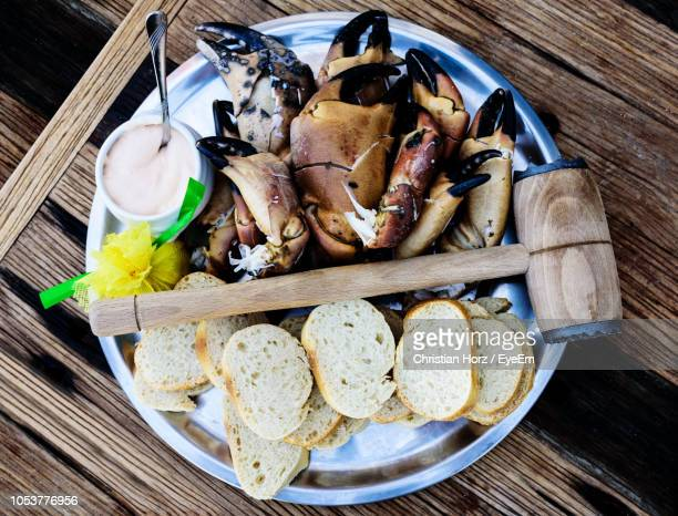high angle view of seafood in plate on table - helgoland stock pictures, royalty-free photos & images
