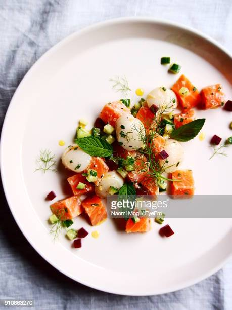 High Angle View Of Seafood Salad In Plate On Table