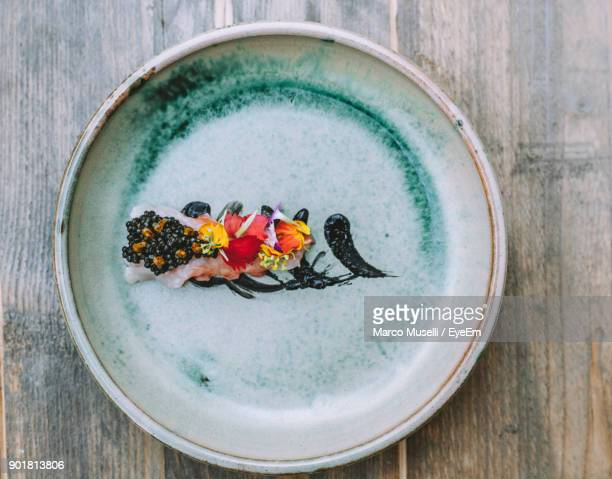 high angle view of seafood served in plate on table - fuengirola stock photos and pictures