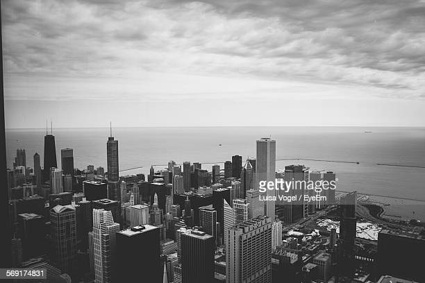 High Angle View Of Sears Tower And Cityscape By Sea Against Sky