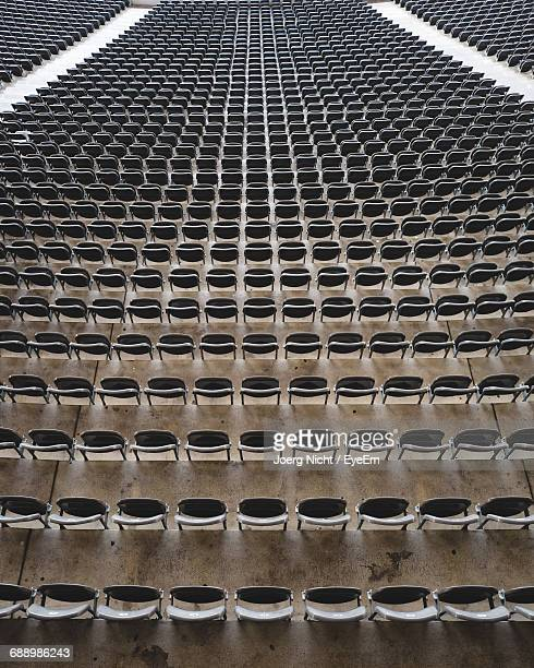 high angle view of seats at olympiastadion berlin - olympiastadion berlin stock pictures, royalty-free photos & images