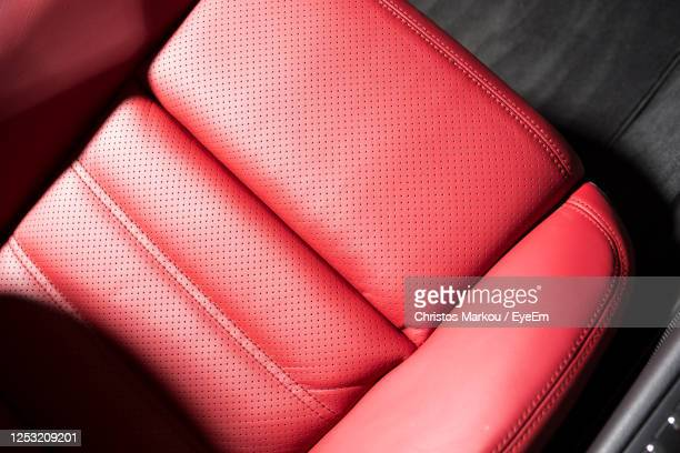 high angle view of seats in car - leather stock pictures, royalty-free photos & images