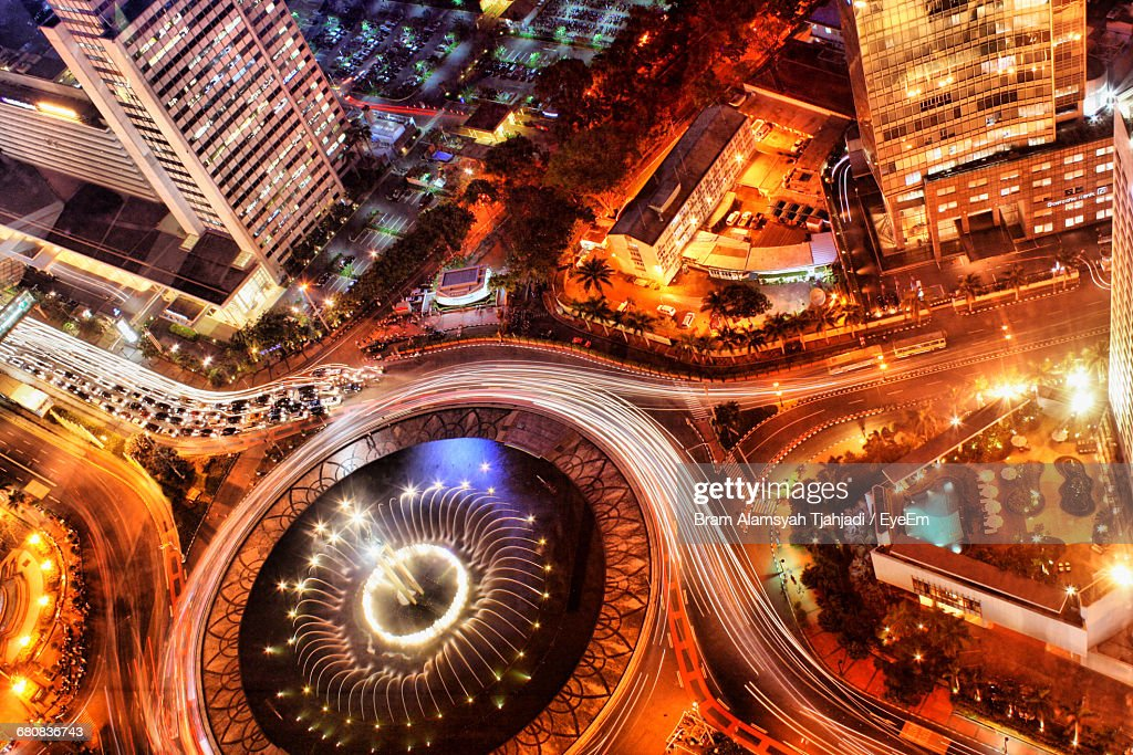 High Angle View Of Selamat Datang Monument In Illuminated City At Night : Stock Photo