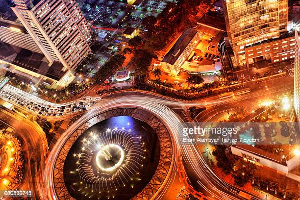 High Angle View Of Selamat Datang Monument In Illuminated City At Night