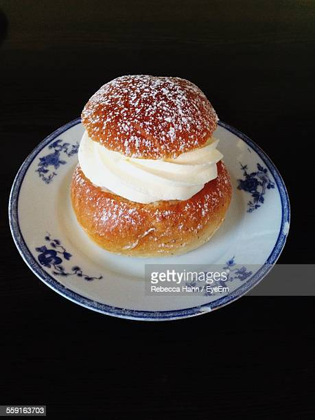 high angle view of semla bun against black background - sweet bun stock pictures, royalty-free photos & images