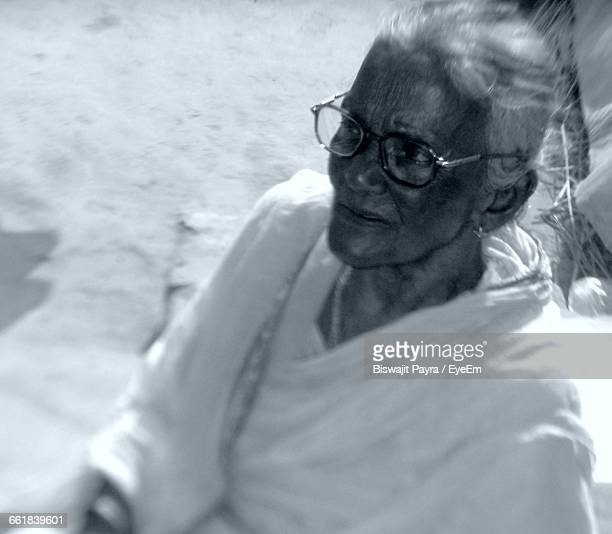 High Angle View Of Senior Woman Looking Away