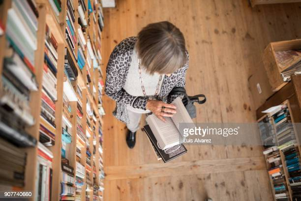 High angle view of senior woman reading book
