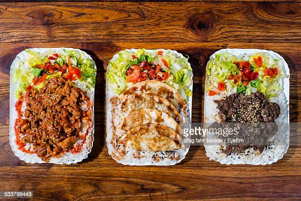high angle view of serving food - paper plate stock photos and pictures