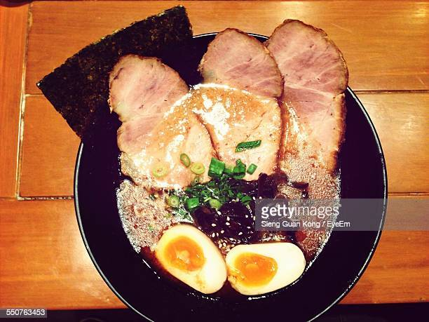 High Angle View Of Serving Ham Slice With Boiled Egg