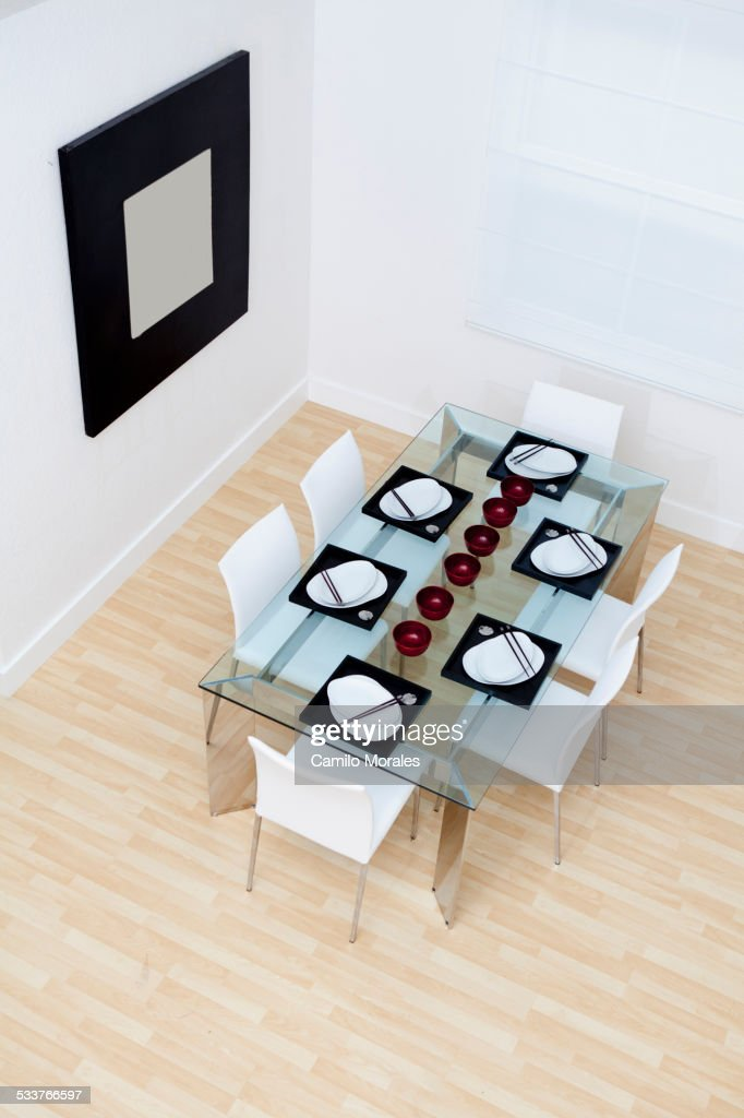 High angle view of set table and chairs in modern dining room : Foto stock
