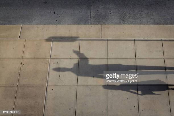 high angle view of shadow on footpath - eyeem jeremy walter stock pictures, royalty-free photos & images