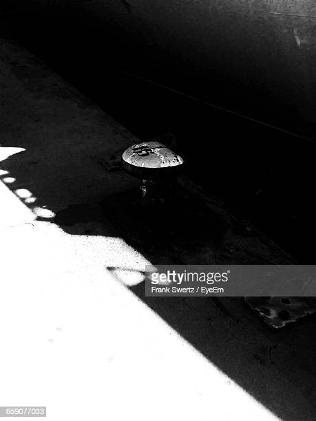 high angle view of shadow on puddle - frank swertz stockfoto's en -beelden