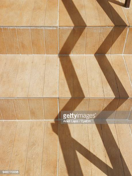 High Angle View Of Shadow On Staircase