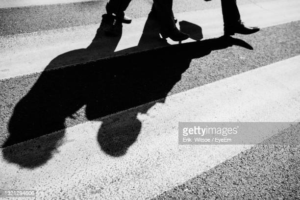 high angle view of shadow on street in city - マゾフシェ県 ストックフォトと画像