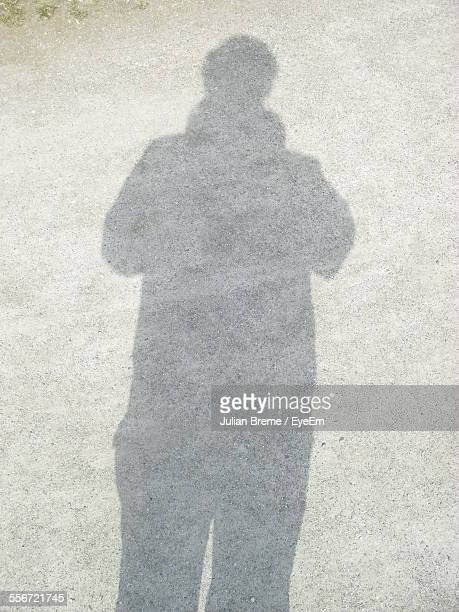 High Angle View Of Shadow On Street