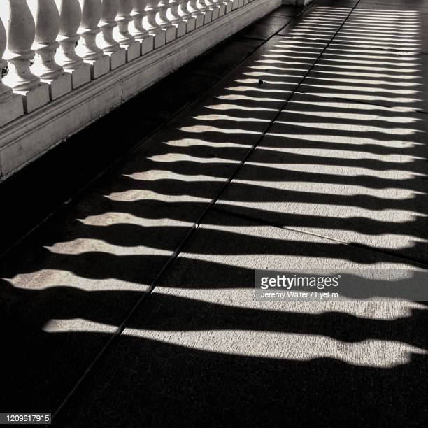high angle view of shadow on tiled floor - eyeem jeremy walter stock pictures, royalty-free photos & images