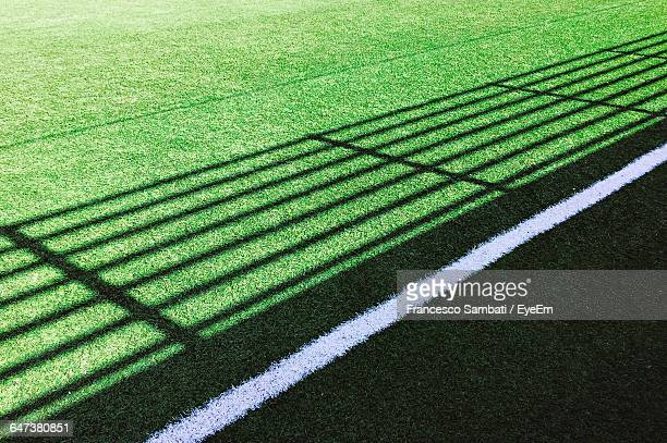 High Angle View Of Shadow Pattern On Playing Field