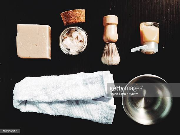 High Angle View Of Shaving Equipment On Table