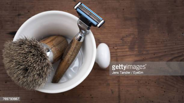 high angle view of shaving equipment on table - shaving brush stock photos and pictures