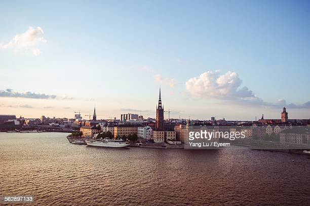 High Angle View Of Ship Moored On River By City Against Sky